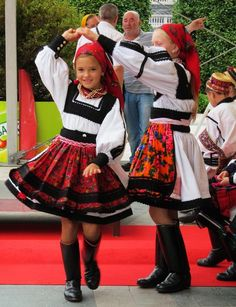 Young Romanian girls having fun in traditional dresses.
