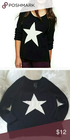 BISOU BISOU  XS Black sweater with white star Black high-low sweater with white star.  Excellent condition, this sweater feels buttery soft, like cashmere. 100 percent acrylic. Bisou Bisou Sweaters