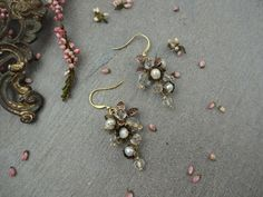 Allasille romantic flower earings made out of lovefreshwater pearls metal flowers Czech glass beads Toho beadsgold -platethooks.  #weddingaccessories #bridaljewelry #bridsmaidsjewelry #bridalearrings #earrings #flowerearrings #latviandesign#freshwater pearls #latviandesigner #jewelery #jewellery #rustic #vintagewedding #vintageweddingjewelry #bohowedding #flowerjewelry#weddingearrings#bridesmaidsjewellery#handmadejewels #antiquestyle #antiquestylejewellery#jewellery #czechbeads #vintage