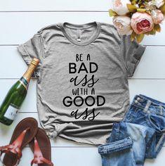 Be a bad ass with a good ass Womens T-shirt Funny Womens Shirts Funny Gym T-shirts by ClothingByShane