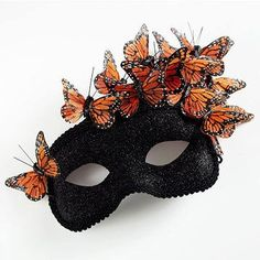 I am amazed on a daily basis with the creativity I find on line. This breath taking mask started as a simple plain Jane and after glitter, trim and creatively placed butterflies, became a work of art!  Created by: Elizabeth Owen of Mabel's House.