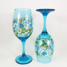 Items similar to Wine Glasses Aqua Blue Flowers with CopperAccents Hand Painted - Set of 2 on Etsy Blue Wine Glasses, Hand Painted Wine Glasses, Copper Accents, Blue And Copper, Pink Daisy, Paint Set, Aqua Blue, Cobalt Blue, Painting Patterns