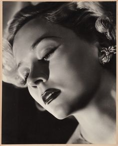 Oversize exhibition portrait of Gloria Grahame by Ernest A. Bachrach. Gelatin-silver matte borderless 15 x 19 in. double-weight print of Gloria Grahame by Ernest A. Bachrach, custom-mounted to 16 x 20 in. presentation mat, and from his private collection. Breathtaking detail in the surface textures of skin, lips, and eyes is due to Bachrach's painstaking and unique lighting skills.