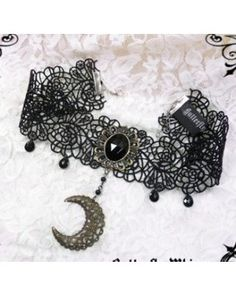 I love his crescent moon choker, I can picture this working well with a big poofy Gothic dress