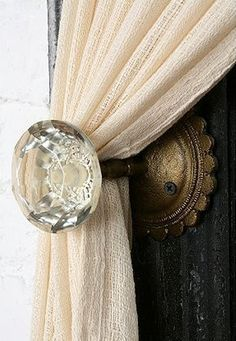 Doorknobs to hold curtains back. Never would have thought of this but it's a fantastic idea!