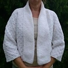 """Hand Knit Crop Sweater Jacket Time to get the sweaters ready, fall and winter are on the way! Beautiful hand knit (by me) short crop sweater with 3/4"""" sleeves. Worsted weight yarn for easy washing. Body is knit in basket weave stitch and the front lapels and neck are knit in seed stitch. Great short jacket to throw over yourself in a cold office or at the movies. Grab it and go. Beautifully hand knit in a Non-smoking home. Lobax  Jackets & Coats"""