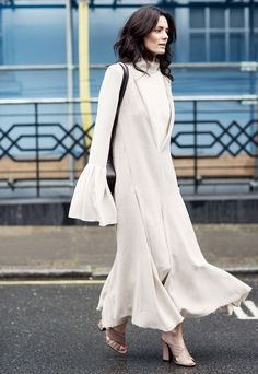 We love the idea of a light-color midi dress that hits right above the ankle because the long silhouette will make your silhouette feel taller.