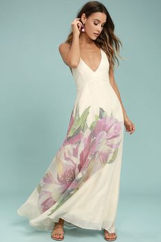 Let the Zen Garden Cream Floral Print Maxi Dress take you to your happy place! Gauzy woven rayon is embellished with a large, pink, green, purple, and yellow floral print, as it falls from skinny straps into a darted, triangle bodice and full maxi skirt. Strappy, open back ties above a bit of elastic for fit.