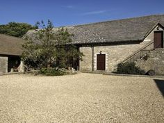 Kingston Country Courtyard, Dorset. Our 18th century Purbeck stone barn, which can seat up to 120 guests, is licenced for civil ceremonies and has a fully stocked bar attached.