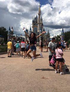 Girl Jumping High At Disney World