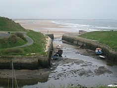 SEATON SLUICE is a village in Northumberland. It lies on the coast at the mouth of the Seaton Burn, between Whitley Bay and Blyth. Part of it was was called Hartley Pans because of the salt-pans.  In 1100 the land was owned by Hubert de Laval, nephew by marriage to William the Conqueror. The de Lavals (or Delavals) settled inland from Hartley Pans and their residence was Seaton Delaval - the name 'Seaton' meaning a settlement (ton) by the sea.