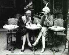 love love love this photo - would love to be the waiter eavesdropping on their conversation.