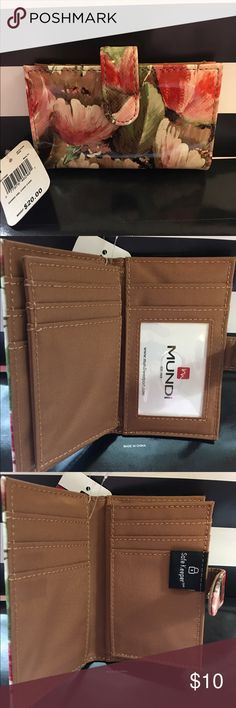 Wallet card case new with tag New with tag Floral  Multi color  11 slots for credit cards 5 slots for receipts  Papers, or money  Non smoking home  No holds no trades    Please take into consideration that I am paying the 20% fees charged by this site, please take that into consideration and the price I am asking thanks Accessories Key & Card Holders