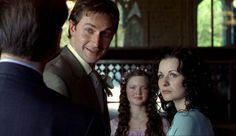 Sparkhouse.  Smiling...the young girl between them is her daughter in the drama.  She later played Meg with Richard Armitage in Robin Hood~