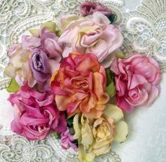 More roses made from white Taffeta ribbon.