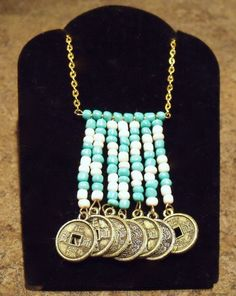 Tribal White And Turquoise Beaded Pendant Necklace With Gold Tone Chain and Gold Tone Oriental Coin Charms