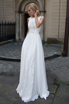 Découvrez la robe Heaven, une robe de mariée en georgette de soie avec un bustier transparent en dentelle de la Collection Style & Élégance.