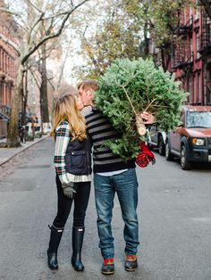 Off to pick your Christmas tree? Turn the activity into a fun engagement session with your other half. (Any other time of year you might look like maniacs posing with a cut conifer.)