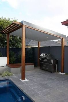 30 Grill Gazebo Ideas to Fire Up Your Summer Barbecues The solid roof of this grill gazebo has a small pergola style overhang near the pool edge, and features an L shaped wooden bench to one side. Small Pergola, Pergola With Roof, Wooden Pergola, Patio Roof, Pergola Patio, Backyard Patio, Pergola Kits, Cheap Pergola, Backyard Plants