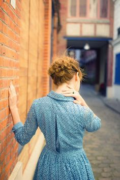 The blue dress, the braided hair...