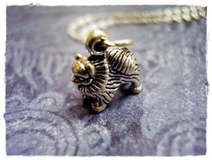 Tiny Pomeranian Dog Charm Necklace in Sterling Silver with a Delicate 18 Inch Sterling Silver Cable Chain ~ $22.00