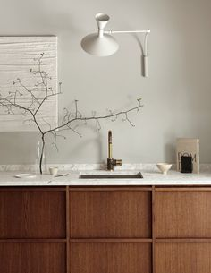 Rustic minimalistic kitchen in dark oak - via Coco Lapine Design blog