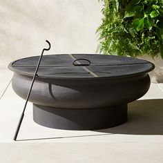 349 x Shop Urli Black Fire Pit. Flying embers no more. Deep solid iron round steps up on round pedestal base in all black. Firepit takes cover under mesh top with center handle, complete with a hook-shaped tool to remove it when stoking and adding logs. Deck With Pergola, Pergola Plans, Pergola Kits, Pergola Ideas, Pergola Patio, Patio Ideas, Black Pergola, Wooden Pergola, Pergola Shade