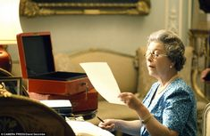 Correspondence: The Queen tackles her red boxes containing government business at Buckingham Palace