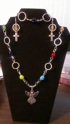Colored easter egg beads with large angel pendant bracelet and earrings...$34 Angel Pendant, Coloring Easter Eggs, Crosses, Angels, Beads, Bracelets, Earrings, Jewelry, Beading