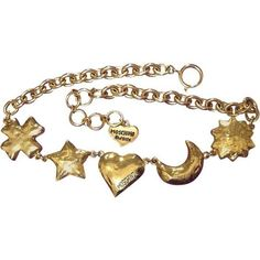 Preowned Mint. Vintage Moschino Chain Statement Necklace With Large Golden Charms. featuring polyvore, women's fashion, jewelry, necklaces, bracelets, accessories, brown, chain necklaces, heart charm necklace, golden necklace, vintage necklace, crucifix necklace and charm necklaces