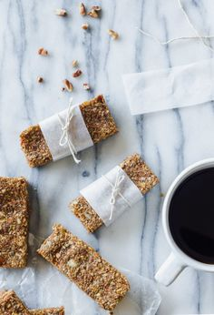 These tasty Carrot Cake Breakfast Bars with Maple Coconut Icing will fuel you through the busiest morning (or toughest of afternoon slumps). #vegan #glutenfree #carrotcake #breakfast #bars