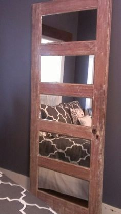 Old door made into à mirror. Sunny