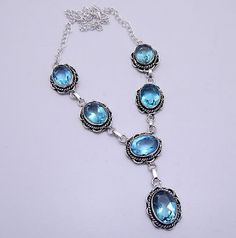 """Blue Topaz Quartz Gemstone Necklace Handmade Jewelry .925 Silver Plated This artisan-made, statement, Blue Topaz gemstone necklace is sure to perfect finishing touch to any outfit. Several of gorgeous  stones are  all connected by silver chain. Modern & Elegant.   -Handmade, OOAK (one-of-a-kind) -18"""" length, silver chain, toggle clasp -Oval blue  Topaz gemstones  Handcrafted by highly skilled artisans who are trained to achieve perfection of every single gemstone jewel"""