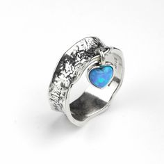 Aviv Silver - Hammered ring with dangly opal heart, £41.99 (http://www.avivsilver.co.uk/hammered-ring-with-dangly-opal-heart/)