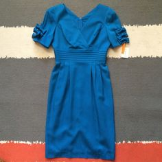 """HPVintage Howard Wolf blue NYE dress—NWT! Vintage Howard Wolf blue party dress—NWT! Never worn. Lined. Beautiful cerulean blue color. Pit to pit, 36""""; waist, 28""""; length, about 43"""". Vintage Dresses"""