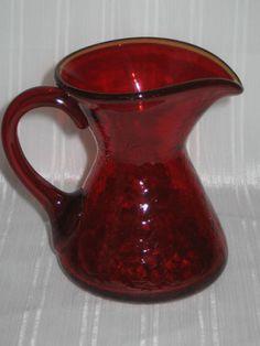 vintage red glass cream pitcher.