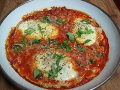 Mario Batali eggs in hell.  Great for the Dukan diet.  I posted this on Dukan's facebook page and then someone added the meat.  Personally I would omit the sausage.