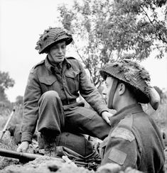 H/Captain John M. Anderson, Chaplain of the Highland Light Infantry of Canada, talking with Private Lawrence Herbert in his trench near Caen, France, 15 July Canadian Soldiers, Canadian Army, Canadian History, Commonwealth, Military Cross, Royal Canadian Navy, British Army Uniform, British Armed Forces, Army Infantry