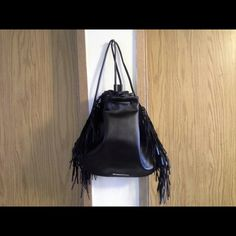 Victoria Secret backpack Victoria Secret black backpack with fring. Pull shut with drawstring. Super cute. NWT. Victoria's Secret Bags Backpacks