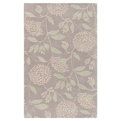 Anchor your master suite ensemble or dining room table in feminine style with this hand-tufted wool rug, showcasing a lovely botanical motif in a soft palett...