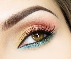 Yellow, orange, and teal eye makeup