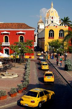 Taxis in Cartagena's old town, Colombia. Without doubt, Cartagena's old city is its principal attraction, particularly the inner walled town, consisting of the historical districts of El Centro and San Diego. (V)
