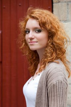 Redhead curly mature woman