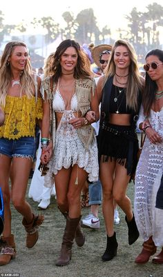 Boho babe! Alessandra Ambrosio flaunted her taut abs and endless legs in a cut-out crochet...