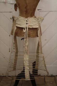 Dress Form. Antique wire bustle. I would love one of these