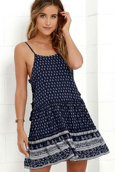 Where fields are flowering and the sun is shining is where you will discover the Wildflower Bouquet Navy Blue Print Lace-Up Dress! Soft woven rayon has an ivory print along its adjustable spaghetti straps and triangle bodice, with tasseled lace-up sides. Relaxed bodice is finished with a fun tiered skirt.