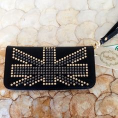 Studded vegan leather wristlet! NWT! Awesome studded wristlet wallet.. Vegan leather and brand new with tags! Great addition to any outfit! Bags Clutches & Wristlets
