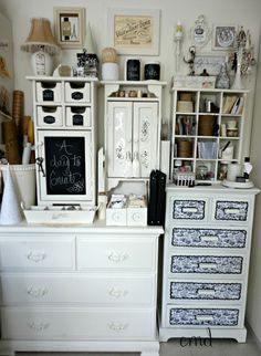 Stacked odd and old furniture pieces painted to make a wall unit for storage in my studio CMD