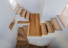 House in Okazaki is arranged around a central block that contains a wooden staircase