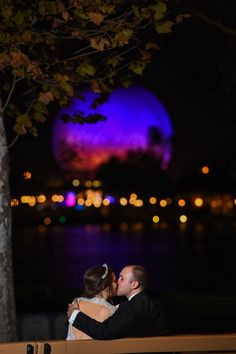 A kiss to end the night after a reception in Epcot! Photo: Stephanie, Disney Fine Art Photography